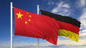 Waving flags of China and Germany on flagpole Stock Image