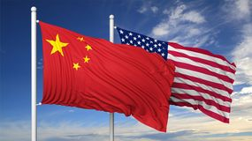 Waving flags of China and USA on flagpole Royalty Free Stock Images
