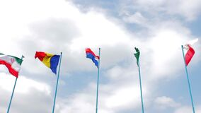Waving flags of the countries of Iran, Moldova, Luxembourg, Pakistan, Poland on flagpoles. The concept of friendship of peoples