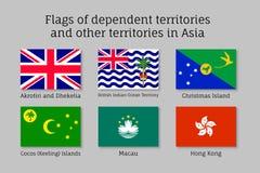Waving flags of dependent territories Stock Photos