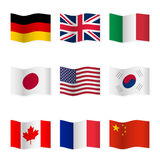 Waving flags of different countries. Stock Photos