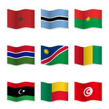 Waving flags of different countries. Stock Images