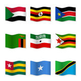 Waving flags of different countries. Flag icons on white background. Vector content. 3D waving position with shadow. Each flag is  on its own layer with the Stock Image