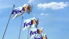 Waving flags with Fedex logo against sky, seamless loop. 4K editorial animation. Waving flags with Fedex logo against sky, seamless loop. 4K editorial clip royalty free illustration