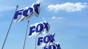 Waving flags with Fox logo against sky, editorial 3D rendering Royalty Free Stock Photos