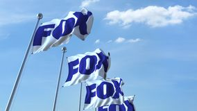 Waving flags with Fox logo against sky, seamless loop. 4K editorial animation. Waving flags with Fox logo against sky, seamless loop. 4K editorial clip stock illustration