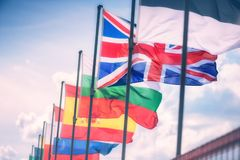 Waving flags in front of European Parliament building royalty free stock photography