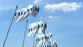 Waving flags with Fujifilm logo against sky, seamless loop. 4K editorial animation. Waving flags with Fujifilm logo against sky, seamless loop. 4K editorial clip vector illustration