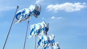 Waving flags with Gazprom logo against sky, seamless loop. 4K editorial animation. Waving flags with Gazprom logo against sky, seamless loop. 4K editorial clip royalty free illustration