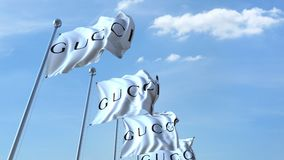 Waving flags with Gucci logo against sky, seamless loop. 4K editorial animation. Waving flags with Gucci logo against sky, seamless loop. 4K editorial clip stock illustration