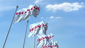 Waving flags with Honda logo against sky, seamless loop. 4K editorial animation. Waving flags with Honda logo against sky, seamless loop. 4K editorial clip vector illustration