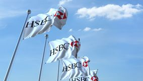 Waving flags with HSBC logo against sky, seamless loop. 4K editorial animation. Waving flags with HSBC logo against sky, seamless loop. 4K editorial clip vector illustration