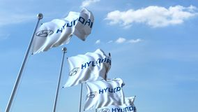 Waving flags with Hyundai logo against sky, seamless loop. 4K editorial animation. Waving flags with Hyundai logo against sky, seamless loop. 4K editorial clip stock illustration