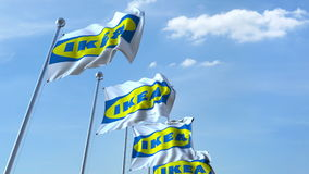 Waving flags with Ikea logo against sky, editorial 3D rendering. Waving flags with Ikea logo against sky, editorial 3D stock illustration