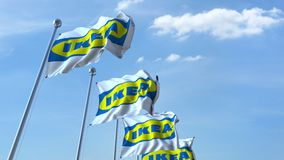 Waving flags with Ikea logo against sky, seamless loop. 4K editorial animation. Waving flags with Ikea logo against sky, seamless loop. 4K editorial clip stock illustration