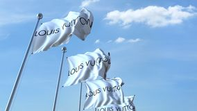 Waving flags with Louis Vuitton logo against sky, seamless loop. 4K editorial animation. Waving flags with Louis Vuitton logo against sky, seamless loop. 4K royalty free illustration