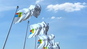 Waving flags with Microsoft logo against sky, seamless loop. 4K editorial animation. Waving flags with Microsoft logo against sky, seamless loop. 4K editorial royalty free illustration