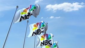 Waving flags with NBC logo against sky, seamless loop. 4K editorial animation. Waving flags with NBC logo against sky, seamless loop. 4K editorial clip royalty free illustration