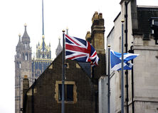Waving flags at the Palace of Westminster Royalty Free Stock Images