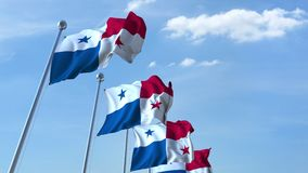 Multiple waving flags of Panama against the blue sky