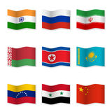 Waving flags of Russian ally countries Stock Photos
