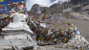 Waving flags in Thorong La Pass - Nepal stock video footage