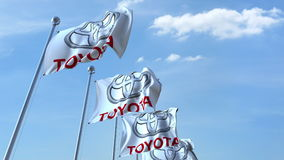 Waving flags with Toyota logo against sky, editorial 3D rendering Royalty Free Stock Photography