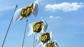 Waving flags with UPS logo against sky, editorial 3D rendering. Waving flags with UPS logo against sky, editorial 3D royalty free illustration