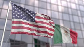 Waving flags of the USA and Mexico in front of a modern skyscraper facade
