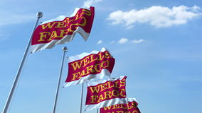 Waving flags with Wells Fargo logo against sky, editorial 3D rendering. Waving flags with Wells Fargo logo against sky, editorial 3D Royalty Free Stock Images