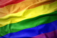 Waving gay rainbow flag . Waving colorful gay rainbow flag royalty free stock photo