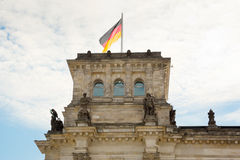 Waving German flag over the Reichstag building in Berlin Stock Images