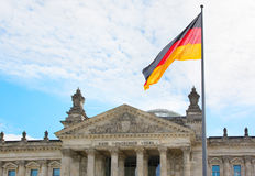 Waving German flag over the Reichstag building in Berlin Royalty Free Stock Photos