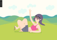 Waving girl on green landscape background. A girl wearing sun glasses, magents top and grey shirts waves lying down on grass with hills landscape and light Stock Photos