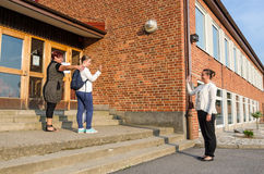 Waving goodbye in first school day Stock Images