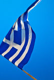 Waving greece flag in the blue sky and flagpole Royalty Free Stock Photography