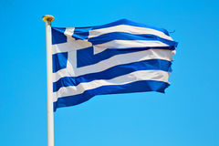 Waving greece flag in  blue sky and flagpole Royalty Free Stock Photography