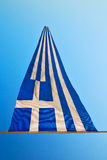 waving greece flag in the blue sky and flagpole Royalty Free Stock Photo
