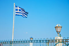 waving greece flag in the and flagpole Stock Images
