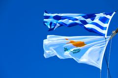 Waving Greek And Cyprian Flags Royalty Free Stock Photography