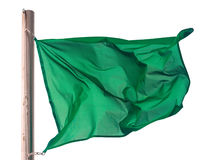 Waving green flag over white Stock Photo