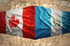 Guatemala and Canada. Waving Guatemalan and Canadian flags on the of the political map of the world Royalty Free Stock Images