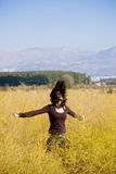 Waving hair in the field Royalty Free Stock Photo
