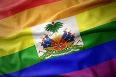 Waving haiti rainbow gay pride flag banner. Waving haiti colorful rainbow gay pride flag banner royalty free stock image