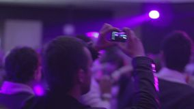 Waving hands in night club`s crowd. People enjoying the party. Stock footage stock video