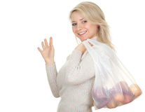 Waving hello woman with plastic shopping bag Stock Photo