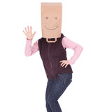 Waving hello woman in smiling paper bag on head Royalty Free Stock Photo