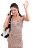 Waving hello woman speaks by phone Royalty Free Stock Images