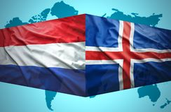 Waving Icelandic and Dutch flags. Of the political map of the world Stock Image