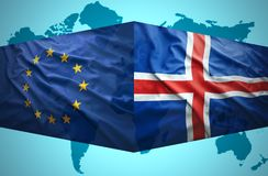 Waving Icelandic and European Union flags Royalty Free Stock Image